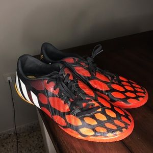 Black and red with orange Adidas Sneakers